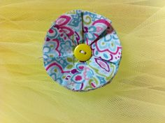 pastel colored fabric flower button clip