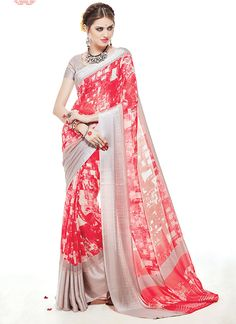 Featuring an impressive red and steel grey digital printed saree with satin silk jacquard border.It is paired with matching blouse material.This blouse can be stitched upto size 42. For stitching enquiries, please email at customercare@hunardesigns.com |…