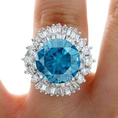 The biggest blue diamond on eBay!!!!  11.85 CARAT GENUINE ESTATE ROUND CUT BLUE DIAMOND ENGAGEMENT RING 14K WHITE GOLD  Click on the picture and check it out yourself.