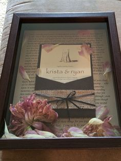 Wedding shadow box- vows written in the background, invitation and dried flowers from the bouquet!