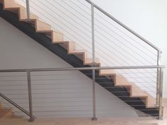BORYANA STAIRCASE - Custom metal staircase with cable railing - Inspiration for University Campus in Middle East by SI architects