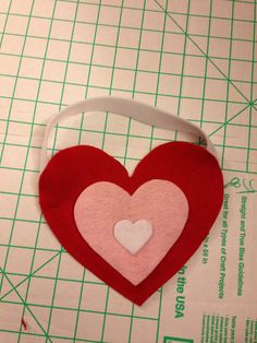 Valentine's card bag for Ayla's class. Made from felt and hot glue. Sooooo easy!