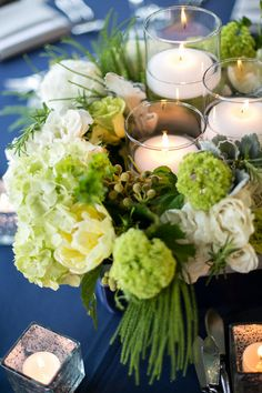 Absolutely adore these wedding floral centerpieces with candles in the middle!