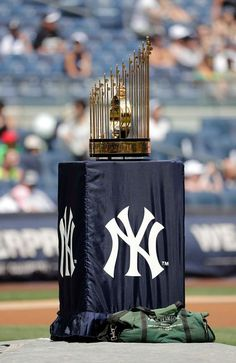 The Commissioner's Trophy sits on the mound during the ceremony before the game…