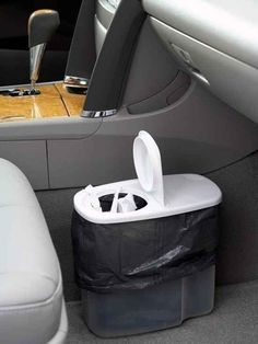 Keep your car clean by using a cereal container as a trash can. 3M Command Adhesive Velcro fasteners to hold it in place. Automobile
