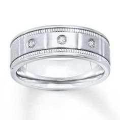Three diamonds dress up this handsome men's wedding band for the guy with sophisticated taste.