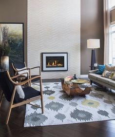 """""""Buy rugs that actually fit your rooms and your furniture,"""" says interior designer Christina Salaway. For a living room rug, avoid one that's too small; make sure at least the front legs of your couch or chairs are touching the rug. The right-sized rug in a complementary style to the room will make the space look larger and feel more """"pulled together."""""""