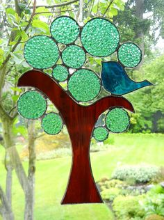 This window hanging is so cheerful and lively with its cute blue bird. The textured greeny-blue tree circles really glow in the sunlight. This is my