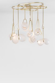 CS.07.02 in brushed brass with milky glass. Lighting designed by Lindsey Adelman.