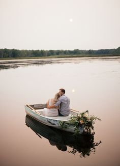 Romantic row boat engagement session