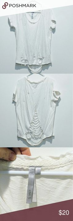 Cutout boyfriend tee Loose fit boyfriend cutout tee. The distressed details give it that edgy look! Short Sleeves frame the crew neckline. This trendy destroyed look is comfortable, Stylish and easy to pair w anything! White. No flaws or stains. EUC and Comes from a smoke free home. Mona B Tops Tees - Short Sleeve