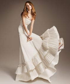 Ivory silk razmir strapless gown with pleated bodice and double flounce hem trimmed with handmade bows
