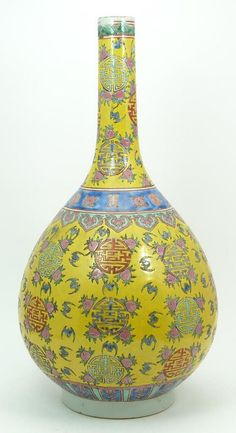 "19th century Chinese kangxi famille rose bottle vase vase, signed in blue to base. Bats and cherries on yellow ground with blue band. 16 1/2"" tall (41.91cm) tall"