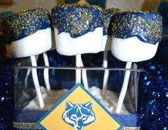Blue & Gold marshmellows on a stick for the Blue & Gold Banquet. Can recreate for FB team. Scout Mom, Girl Scouts, Cub Scouts Wolf, Cheer Banquet, Arrow Of Lights, Gold Candy, Cheer Party, Cheer Gifts, Scout Activities