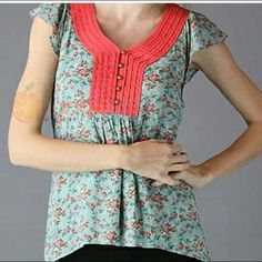 Top Darling small flower contrasting front yoke top coming soon  buttons on front love the colors in this top. Goes with denim jeans is shorts. Can be worn with favorite skirt because of the tie back feature. Tops