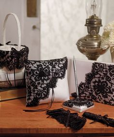 Beverly Clark Gala The dramatic black hand beaded lace on this collection is stunning against an ivory matte satin. Its modern style in black makes it an ideal accessory for a formal wedding ceremony.   Join Brides advantage Club Free Membership,To Access 3000 Designer Wedding Accessories.    http://www.bridesadvantageclub.com/Default.aspx?pageId=1475781