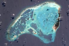 coral barrier breaks the waves and protects the lagoon of this uninhabited island in the archipelago of los roques, venezuela