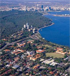 University of Western Australia closely to the Swan River. Skyline of Perth in the background.