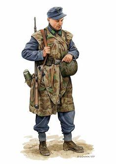 1939-2945 Soldado alemán con poncho Mimetizado. Era una pieza triangular con la que junto con a otras tres se formaba la fienda de campańa. German WW2