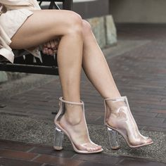 Look classy and chic in a pair of peep toe clear heel boots.