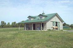 Nice small Morton horse barn with overhang, dormers and cupolas.