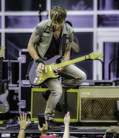 """Keith Urban Photos - Image processed using digital filters) Keith Urban performs older and brand new music from his new album """"Ripcord"""" during his Free Concert For Fans outside Bridgestone Arena on May 9, 2016 in Nashville, Tennessee. - Keith Urban Free Concert For Fans"""