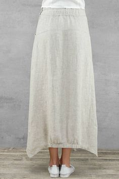 Long linen skirt, made of high quality natural linen colour linen (melange of white and natural linen colour threads). Long, with two pockets. Elasticated waist. Its perfect for summer, also fashionable, modern, stylish. High quality sewing. Composition: 100 % linen. Pre washed. Measurements: detail measurements are in last photo. Sizes: EU 36-44 EU 36- US 4- UK8 EU 38- US 6- UK10 EU 40- US 8- UK12 EU 42- US 10- UK14 EU 44- US 12- UK16 Easy care: hand wash/ machine wash (40).