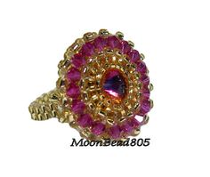Swarovski Elements Crystal Rivoli and Bicone beaded ring in Fuchsia and Volcano