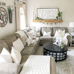 .love the white pillows and blanket plus black coffee table