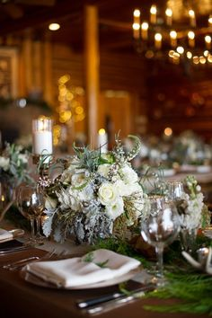 Winter wedding centerpiece idea - white + greenery flower arrangement and tall candles {Jamee Photography}