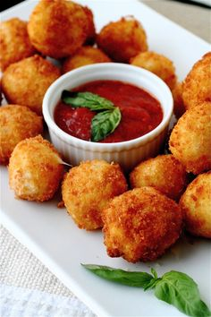 Recipe for Fried Mozzarella with Spicy Marina Dipping Sauce - Little nuggets of fresh mozzarella cheese, known as bocconcini, are breaded and deep-fried, then paired with a piquant tomato sauce for dipping. Serve as part of an antipasti platter for an Italian-inspired meal.