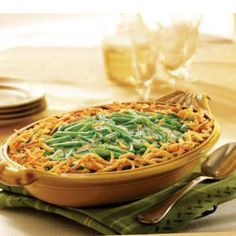 This expanded version of traditional Green Bean Casserole is sure to satisfy any crowd with its flavorful combination of cream of mushroom soup, green beans, milk, seasonings and crispy French fried onions.