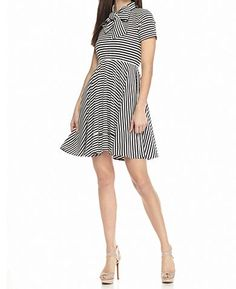 Look sophisticated for any day with this NATT TAYLOR® Lola Striped Short Sleeve Dress! Covered all over in snazzy stripes with a feminine-chic tie detail, this fit-and-flare design is a wardrobe must-have.