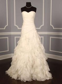 Monique Lhuillier Devotion. RUFFLES. i hate to pin wedding dresses but i have a weakness for ruffles.
