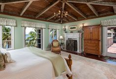 beautiful Florida master bedroom with water views