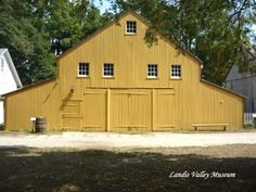 Yellow barn at the Landis Valley Museum, a living history village and farm, which collects, preserves and interprets the history and material culture of the Pennsylvania German rural community from 1740 to 1940