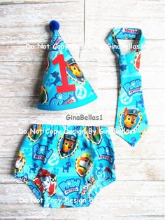Paw Patrol Birthday Party outfit cake smash diaper cover and tie (I can take a request if you prefer a certain Puppy on the tie) ▄▄▄▄▄▄▄▄▄▄▄▄▄▄▄▄▄▄▄▄▄▄▄▄▄▄▄▄▄▄▄▄▄▄▄▄▄▄▄▄▄▄▄▄▄▄▄▄▄▄ Set includes Diaper Cover with elastic waist and leg for comfortable / flexible fit Fabric Hat #1 Birthday