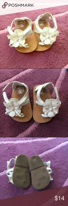 Roxy sandals size 6-12 months White Roxy sandals with cute white flower on top.  Size 6-12 months. Some wear on bottoms but still on good condition :). Roxy Shoes Sandals & Flip Flops