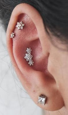 Delicate Multiple Ear Piercing Ideas at MyBodiArt.com - Crystal Flower Constellation Cartilage Piercing Jewelry 16G - Triple Flower Conch Stud