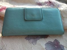 Vintage 1954 Light Blue Genuine Leather FOSSIL Wallet Fossil leather check book wallet. Several card slips. One outside zip pocket for change/receipts. Beautiful, vibrant jade/turquoise exterior w/ l