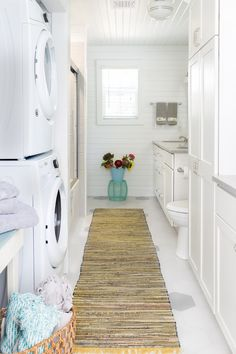 This cheerful bathroom design incorporates all sorts of small space planning ideas. The laundry is combined with the bathroom, and a door off the porch allows for the entire space to function as a mudroom in addition to a kids bathroom. The toilet is tucked away behind the pantry for some privacy and a large laundry sink functions for both laundry and mudroom needs. The double bowls with long countertop ensure little fighting over space amongst the three kids who reside there. The white ...