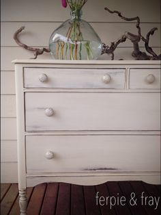 Dresser painted by Ferpie and Fray in General Finishes Milk Paint, Antique White (with dark wax)