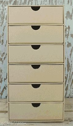 DIY component cabinet. I like this for the travel theme- like a mini-suitcase.