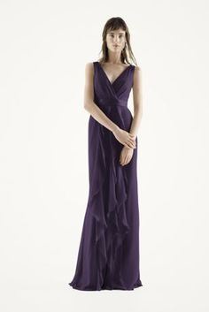 This V-neck wrapped bodice dress is timeless and romantic; perfect for your wedding party or any special occasion!  Sleeveless V-neck wrapped bodice is adorned with an elegant satin belt.  Long, soft chiffon skirt features cascading bias cut ruffles.  Sizes 0-26.  Fully lined. Back zipper. Imported chiffon. Dry clean only. Amethyst.
