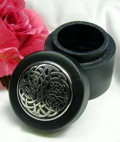 The Irish Wake - Irish Mini-Keepsake Cremation Urn: Round Wood Box with Pewter Knot Medallion, $22.00 (http://www.irishwakestore.com/irish-mini-keepsake-cremation-urn-round-wood-box-with-pewter-knot-medallion/)