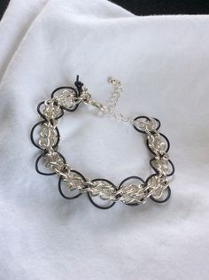 A personal favorite from my Etsy shop https://www.etsy.com/listing/234700518/silver-colored-chain-and-black-leather