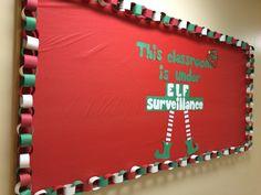 December/Christmas bulletin board. This classroom is under elf surveillance