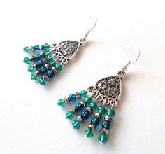 I love how sparkly and festive these earrings are! They even seem to dance as they dangle! I obviously was going for a shimmery look, so I used tiny green, turquoise and silver crystals. They all dangle from a very pretty filigree charm. At 1 1/2 inches long (starting from the