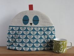 Hand Screen Printed Owl Tea Cosy in Teal by robinandmould on Etsy - would go perfectly with my owl teapot. Adorable.