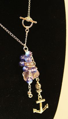"""Pendant charm necklace, wire wrapped upcycled lavendar glass, round blue glass beads, silver anchor and spiral charms, hand-made, 18"""", 46 cm..."""